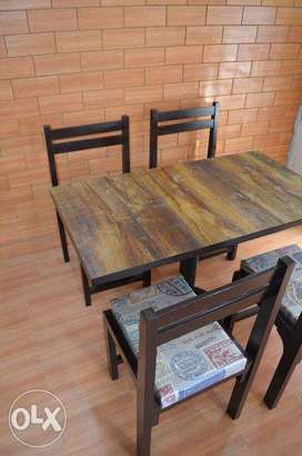 Four wooden chairs and cafe table in lahore
