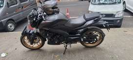 Dominar 400cc with ABS black. Bike in showroom condition. Second owner