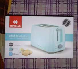 BRAND NEW SEALED PACKED HAVELLS TOASTER...