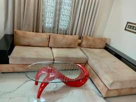 L shape sofa and glass teapoy