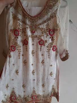 Beautifully designed white dress with elegant gold stone work