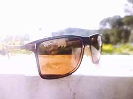 Rayban sunglases with branded pouch and fibre cloth