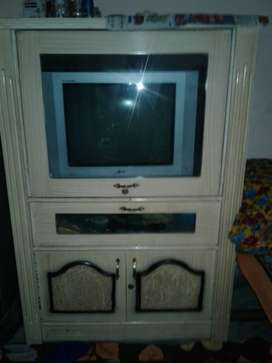 Gray CRT TV With Gray Wooden TV Hutch