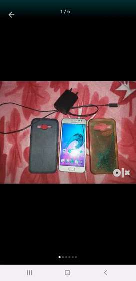 Samsung Galaxy J2 with samsung original charger and 2 covers