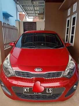 Mobil KIA RIO Automatic 2013 Merah Metalic