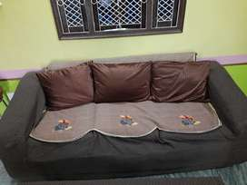 Designer sofa with cover