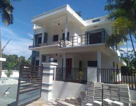 A STRIKING NEW 4BED ROOM 1900SQ FT 8CENTS HOUSE IN KAIPARAMBU,TSR