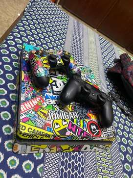PS4 Slim 500Gb With GTA 5,Star Wars,Call of Duty And 2 Controllers