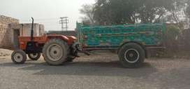 Tractor and trolley for sale new tyre new engine neat and clean