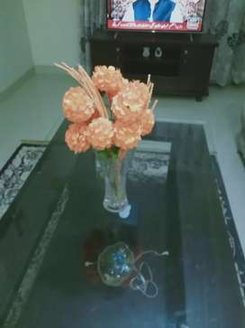 Glass vase with new beautiful orange flower bunch