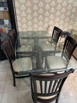 Glass top dining table with 5 chair , 6'x3.5 Ft, New condition