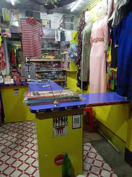Shop podium with cash drawers and showcase for garments