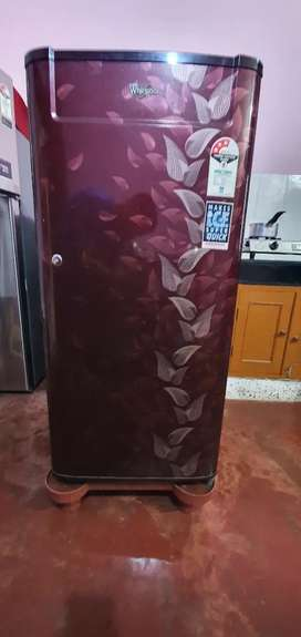 Red whirlpool refrigerator, in excellent condition