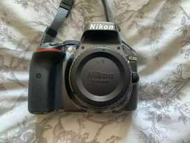 Nikon D5300 with 50mm 1.8 lens with all things