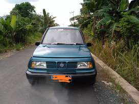 Suzuki escudo JLx hijau