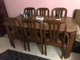 Dining table with 6 chairs made of wood