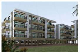 Spacious 2 & 3BHK flats Rs.39Lakhs onwards near MES College on highway