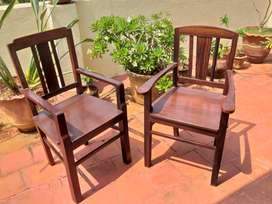 Two solid rosewood chairs