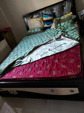 Queen bed with headrest, storage and mattress for sale.