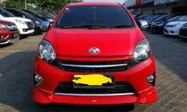 Di jual mobil Agya matic warna merah tahun 2016