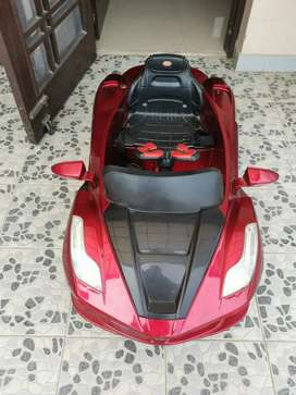 Kids ride on battery operated ferrari car and  pedal bicycle