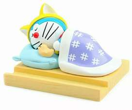 Boneka dashboard doraemon