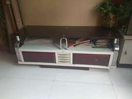 Tv unit with glass top
