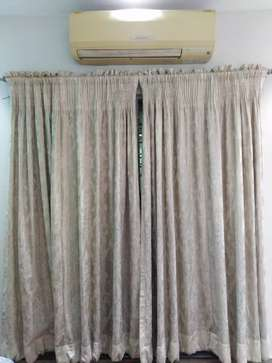 Curtains in off white colour