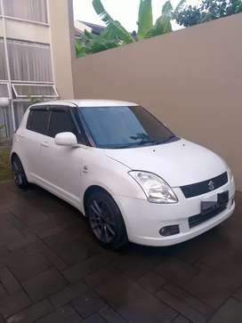 Swift GL CBU 2006 warna putih