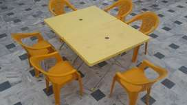 Plastic tables x 2 and 6 plastic baby chairs Boss Brand