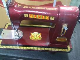 Sewing machine manufacturers and trader