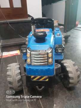 Tractor for kids . It can lead more than 70 kg . 2. Half month old