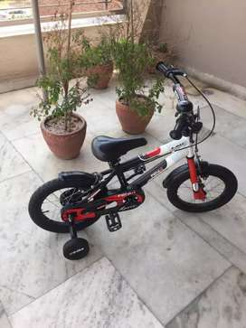 Child bicycle with spotters