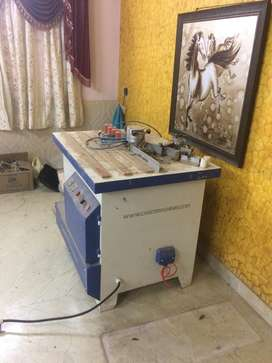 Edge banding machine manuual along with Air compressor to run it