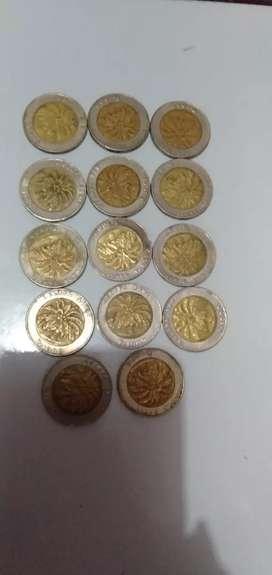 Uang koin Rp 1000 kelapa sawit