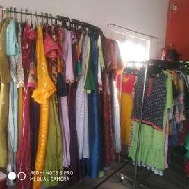 Designer dresses with machines, stands, website