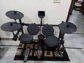 Alesis DM6 electronic drum kit with dolphin stool