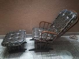 Rocking chair with rocking foot rest in good condition