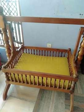 Baby wooden cradle ( തൊട്ടിൽ )