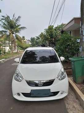 Daihatsu Sirion 2012, warna putih jual cepat.