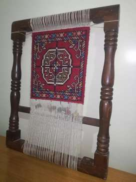Wooden and rug hanging artifact