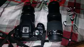 Canon Eos 200d with 2 lens and  Tripod .