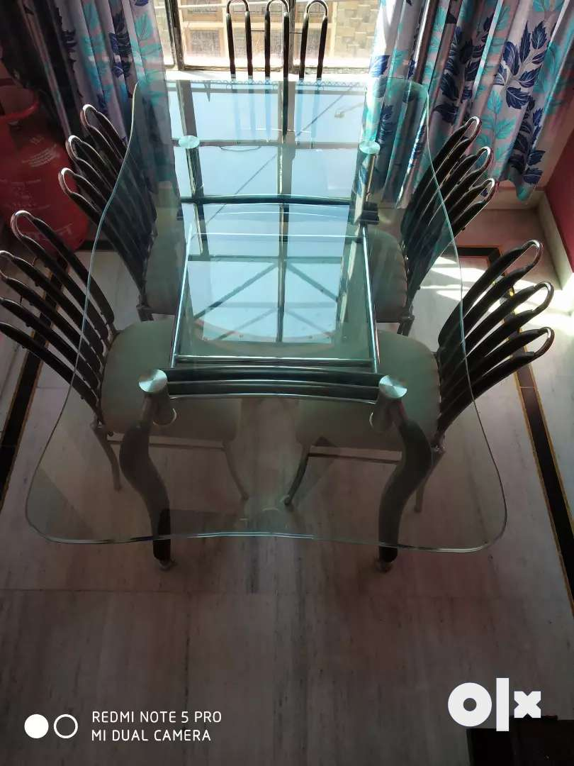 A luxury designer double glass dining table with six chairs 0
