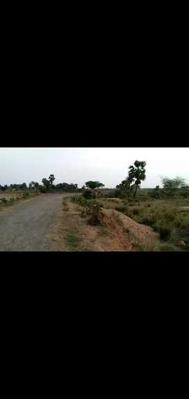 NH to 5km distance 700/-per sqrft with gharabari & boundary wall