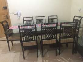 Glass table with 8 dinning chairs