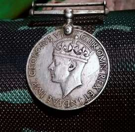Old coin and second world war medal