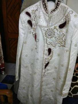 sherwani in off white color with maroon stall