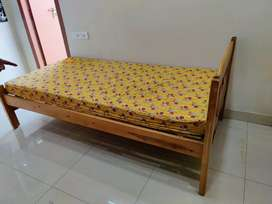 Hardwood bed with mattress