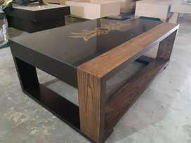 Designer center table now in your range with a golden touch