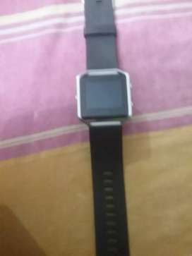 Fitbit blaze with charging cable.